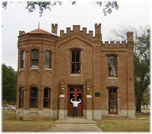Bill Norton at front of Hammond House in Calvert, Texas